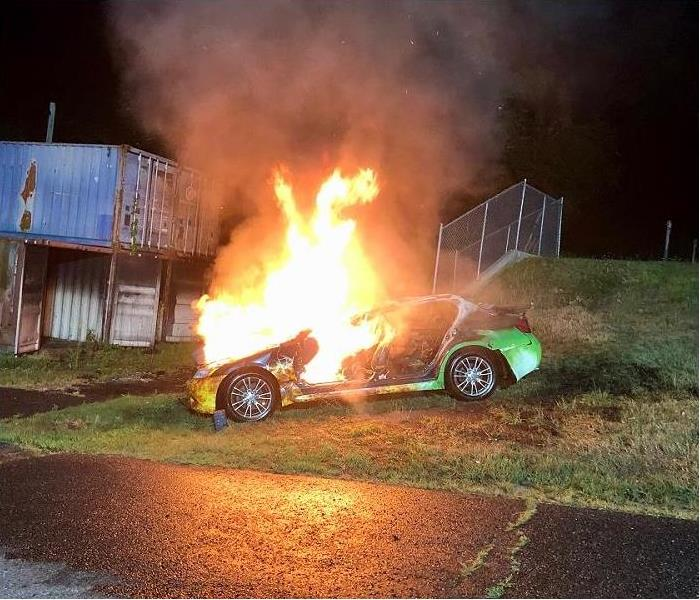 Retired SERVPRO car being being burned