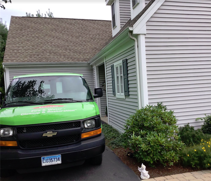 SERVPRO attending to a water damage situation - image of SERVPRO vehicle in driveway